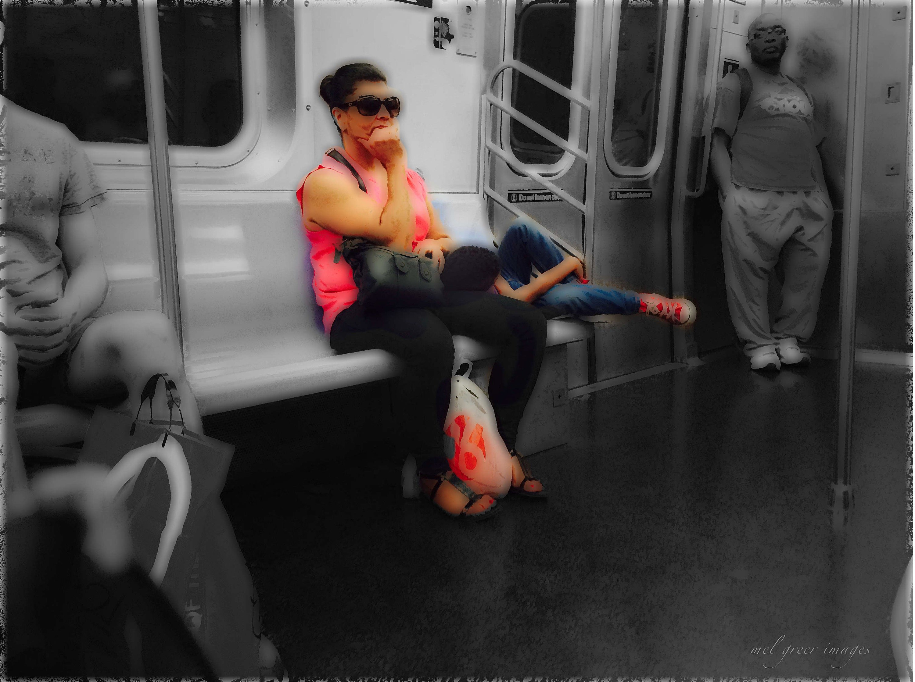 Woman with child on the subway